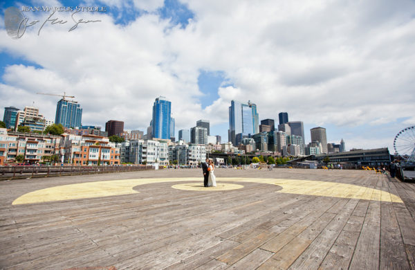 Bride and Groom at the Piers with Seattle Skyline