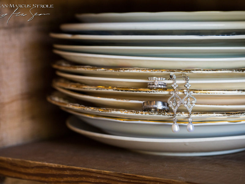 Detail Photography of a Bride and Grooms Wedding Rings and Earings
